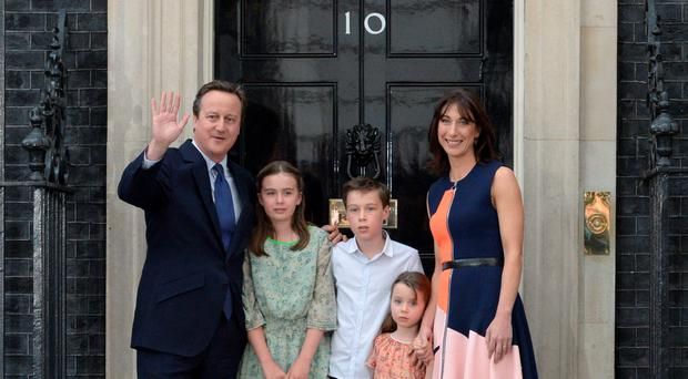 David Cameron (L) waves outside 10 Downing Street with his family (L-R) his daughter Nancy Gwen, son Arthur Elwen, daughter Florence Rose Endellion and his wife Samantha Cameron AFP PHOTO / OLI SCARFFOLI SCARFF/AFP/Getty Images