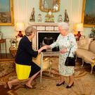 Queen Elizabeth II welcomes Theresa May at the start of an audience in Buckingham Palace, London, where she invited the former Home Secretary to become Prime Minister and form a new government. PA