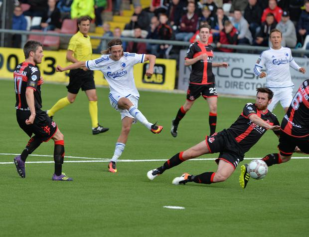 Take that: Copenhagen's Ramus Falk hits the back of the net as Crusaders are put to the sword at Seaview yesterday