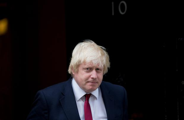 Newly appointed Foreign Secretary Boris Johnson leaves 10 Downing Street in central London after new Prime Minister Theresa May gave him the role. / AFP PHOTO / JUSTIN TALLISJUSTIN TALLIS/AFP/Getty Images
