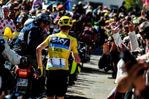 Great Britain's Christopher Froome (C), wearing the overall leader's yellow jersey, runs to get a replacement bike following a fall during the 178 km twelvelth stage of the 103rd edition of the Tour de France cycling race on July 14, 2016 between Montpellier and Chalet-Reynard. / AFP PHOTO / JEFF PACHOUDJEFF PACHOUD/AFP/Getty Images