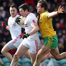 Old foes: Michael Murphy and Sean Cavanagh are both able to inspire their sides to victory