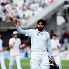 Rolling back the years: Pakistan captain Misbah-ul-Haq salutes the crowd after hitting a century at Lord's aged 42