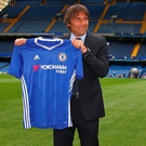 Getting shirty: Antonio Conte is unveiled as Chelsea manager at Stamford Bridge
