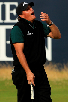 Agonisingly close: Phil Mickelson shows his disbelief and dejection after a lip-out on the 18th hole prevented him from becoming the first person to shoot a round of 62 in a Major