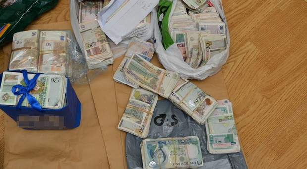 Bundles of cash seized by police during raids in Armagh this week