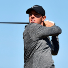 Driving ahead: Rory McIlroy en route to a two-under-par opening round at The Open
