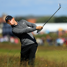 Rough times: Rory McIlroy gets himself out of trouble yesterday