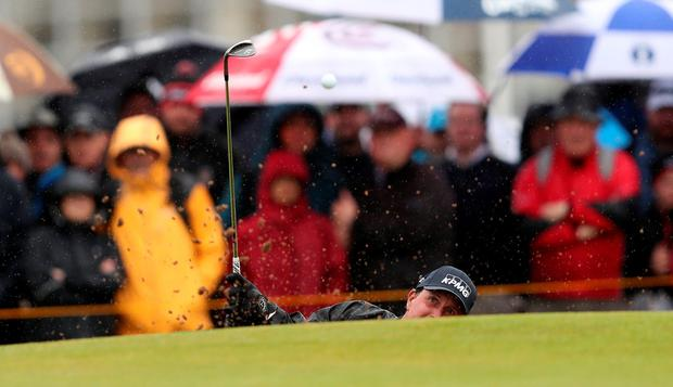 USA's Phil Mickelson chips out of a bunker during day two of The Open Championship 2016 at Royal Troon Golf Club, South Ayrshire. PA