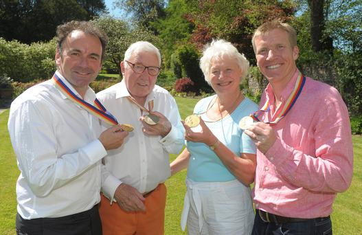 Glittering line-up: unique picture of Northern Ireland's four Olympic gold medallists (from left) Stephen Martin, Lord Glentoran Robin Dixon, Dame Mary Peters and Jimmy Kirkwood. Stephen Martin believes their exclusive club could be joined next month by one or all of Michael Conlan, Paddy Barnes, and brothers Peter and Richard Chambers