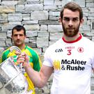 Switch of allegiance: Ronan McNamee, with Donegal's Frank McGlynn looking on, now stars for Mickey Harte's Tyrone side but he grew up wearing the green and gold of Donegal