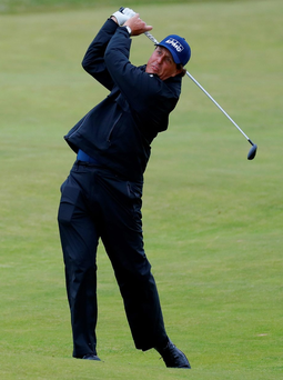 Moving ahead: Phil Mickelson hits an approach shot en route to extending his lead at the top of the leaderboard