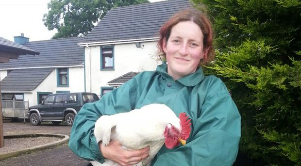 Samantha Phillips with a rescued broiler chicken at the animal sanctuary
