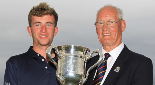 Top man: Sean Flanagan (Co. Sligo) is handed the North of Ireland Amateur Open Championship by Eamonn O'Connor, Chairman Ulster Branch GUI