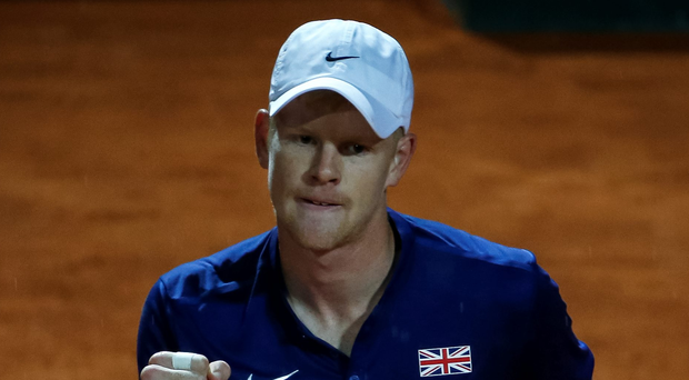 Smash hit: Kyle Edmund secures a superb win over Janko Tipsarevic to give Great Britain a 1-0 lead