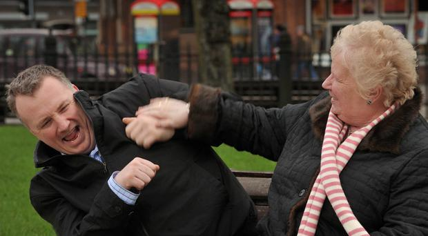Stephen Nolan and his mum Audrey larking around in the grounds of Belfast City Hall