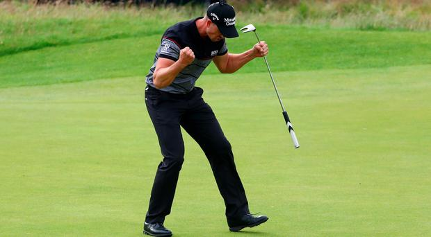 Henrik Stenson of Sweden celebrates victory after the winning putt during the final round on day four of the 145th Open Championship at Royal Troon on July 17, 2016 in Troon, Scotland. Henrik Stenson of Sweden finished 20 under for the tournament to claim the Open Championship. (Photo by Matthew Lewis/Getty Images)