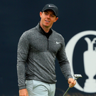 Rory McIlroy reacts to a missed putt on the 18th
