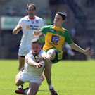 All action: Tyrone's Niall Sludden dives in