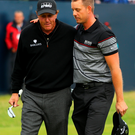 Henrik Stenson shares a few words with runner-up Phil Mickelson