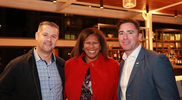 Carlos Collins from Kilkeel and his wife Lini join Andrew Cowan (right) of NI Connections at a recent event in Sydney