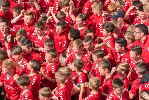 Jon Clifford's Tristar Boy's football teams arrive in Guildhall Square in Derry-Londonderry after a city centre parade at the start of the Hughes Insurance Foyle Cup. The annual tournament will see 2000 players from 310 teams playing over 1000 games across the North West. Picture Martin McKeown. Inpresspics.com. 19.07.16