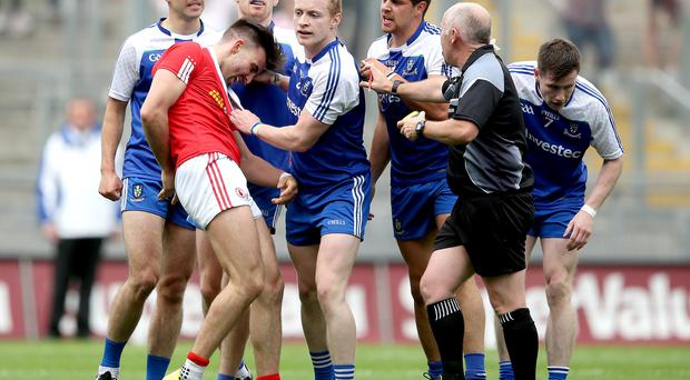 Get a grip: Tyrone's Tiernan McCann incurs the wrath of the Monaghan players last year