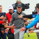Star quality: Rory McIlroy gets up close with the fans during the final round of The Open at Royal Troon