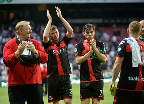 Different class: Roy McDonald (left) joins the Crusaders players to applaud the fans at end of last night's loss against Copenhagen at the Parken Stadium
