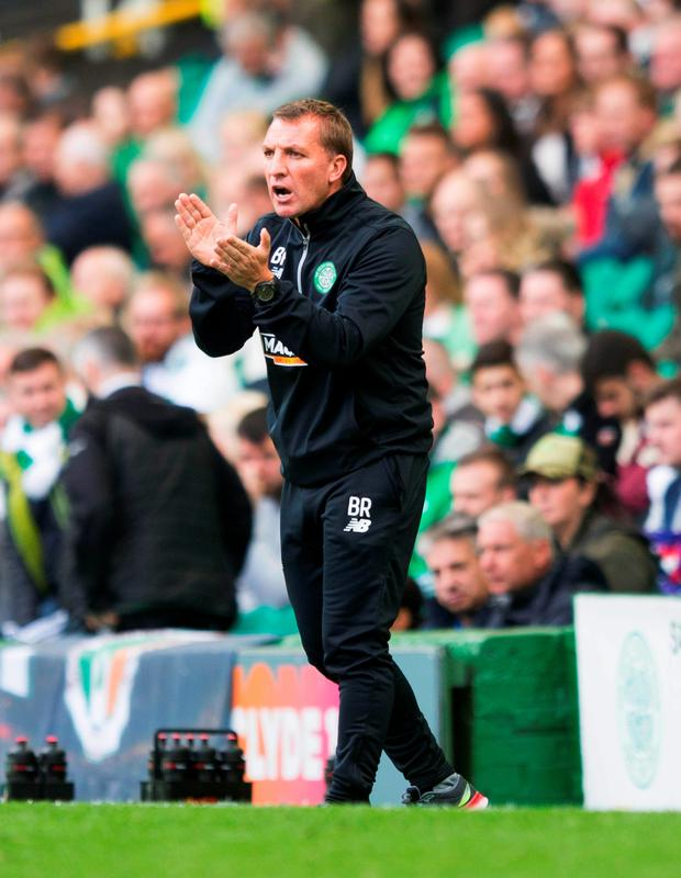On the front foot: Brendan Rodgers urges his Celtic side to a 2-1 win over Wolfsburg in the Parkhead friendly at the weekend