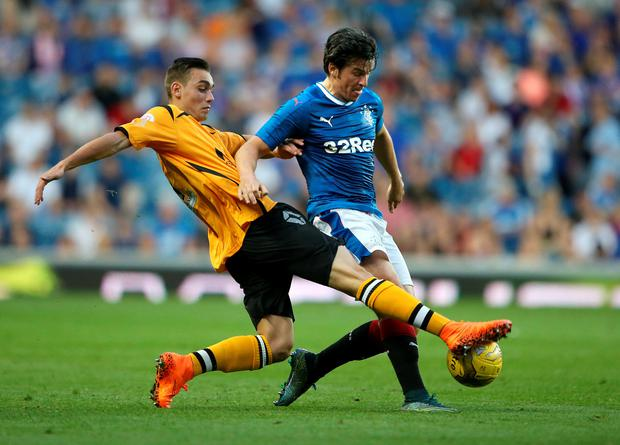 Big-name signing: Joey Barton makes his Rangers debut last night, coming on as a substitute in the 2-0 win over Annan at Ibrox