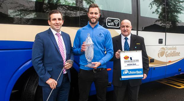 Translink service delivery manager John Morgan and Ulsterbus Inspector Danny Halliday with Galgorm Castle's Ross Oliver and the trophy for the Tayto Northern Ireland Open, in partnership with Ulster Bank.