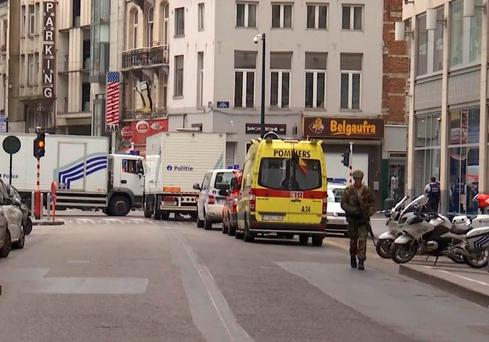 In this framegrab taken from APTN, a soldier walks along a street in Brussels, Belgium, Wednesday July 20, 2016. (AP Photo/APTN)