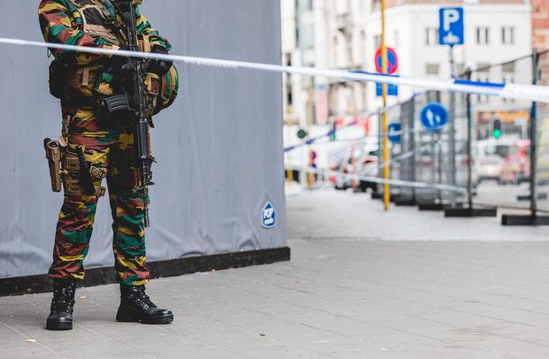 An armed soldier stands behind a cordon in central Brussels on July 20, 2016. AFP/Getty Images