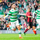 On target: Patrick Roberts scores Celtic's third goal at Parkhead