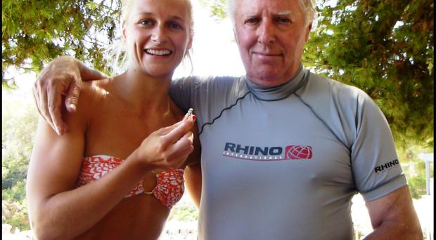 Pic: GeorgeEdmunds/BNPS Katie Patterson with George Edmunds and the ring.