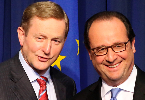 French President Francois Hollande (R) shakes hands with Ireland's Prime Minister Enda Kenny (L) during a joint press conference at the Goverment buildings in Dublin, Ireland, on July 21, 2016. AFP/Getty Images