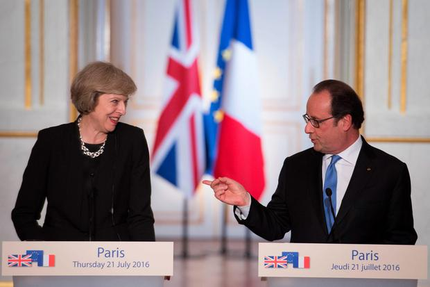 Prime Minister Theresa May holds a joint news conference with French President Francois Hollande at the Elysee Palace, Paris after they had a bilateral meeting. PA