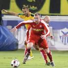 Battle: Chris Curran battles for Cliftonville in the second leg last night