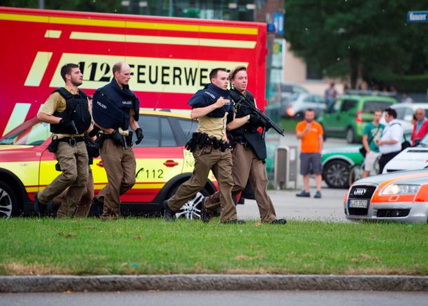 Police walks near a shopping mall amid a shooting on July 22, 2016 in Munich. AFP/Getty Images