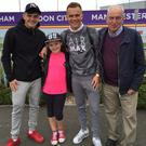 Family pride: Ronan, Rory and Danny Hale are joined by the boys' sister Caity before a trip to England