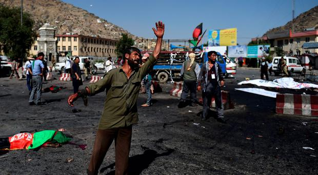 An Afghan protester scream near the scene of a suicide attack that targeted crowds of minority Shiite Hazaras during a demonstration at the Deh Mazang Circle in Kabul on July 23, 2016. AFP/Getty Images