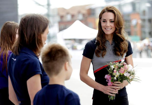 The Duchess of Cambridge meets members of the 1851 Trust at the Land Rover BAR team base during a visit to Portsmouth to see the America's Cup World Series. PRESS ASSOCIATION Photo. Picture date: Sunday July 24, 2016. See PA story ROYAL Americas. Photo credit should read: Henry Browne/PA Wire