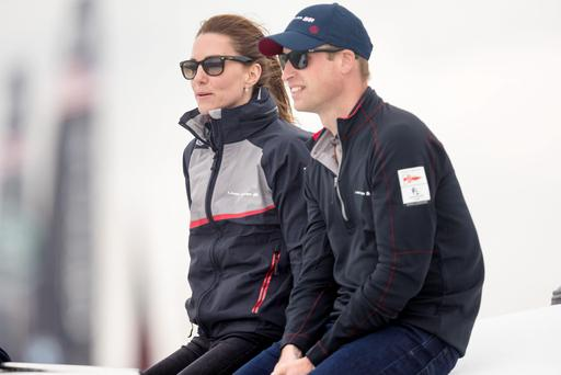 The Duke and Duchess of Cambridge watch Sir Ben Ainslie's Land Rover BAR team racing from a chase boat during day four of the America's Cup World Series Portsmouth event. PRESS ASSOCIATION Photo. Picture date: Sunday July 24, 2016. See PA story SAILING Americas. Photo credit should read: Christopher Ison/PA Wire.
