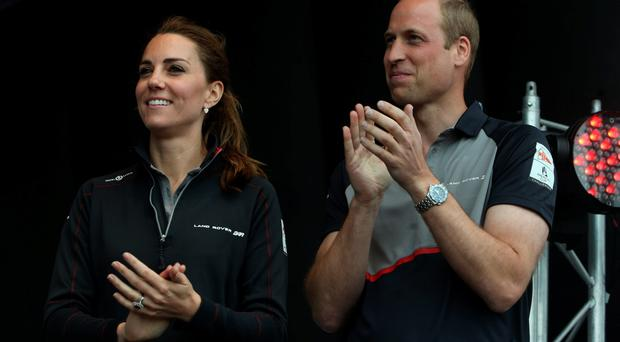 The Duke and Duchess of Cambridge take part in a presentation ceremony at the conclusion of the America's Cup World Series Portsmouth race. PRESS ASSOCIATION Photo. Picture date: Sunday July 24, 2016. See PA story ROYAL Americas. Photo credit should read: Steve Parsons/PA Wire