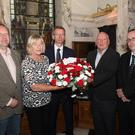 Councillors Graham Craig (UUP), Aileen Graham (DUP), Brian Kingston (DUP), Jeff Dudgeon (UUP) and Lee Reynolds (DUP). elfast City Councillors preparing to lay a floral wreath this afternoon beside the memorial plaque in City Hall in remembrance of the victims of the IRA bombing atrocity in Belfast on Bloody Friday.