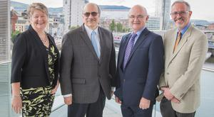 From left: Ellvena Graham, Brian Branch of the World Council of Credit Unions, Brian McCrory, president of the Irish League of Credit Unions, and Tim Husbands of Visit Belfast