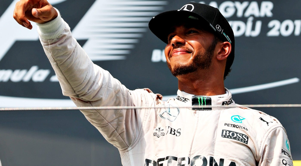 Pumped up: Lewis Hamilton salutes his victory in Hungary yesterday that puts him ahead of Mercedes team-mate Nico Rosberg in the F1 world title chase