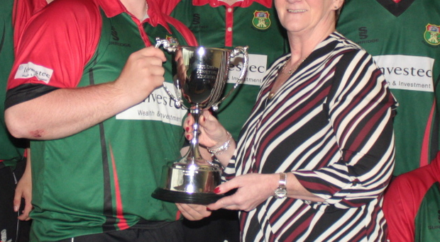Captain's pride: Ballyspallen's Stephen Kennedy receives the Eric Cooke Plate trophy from Valerie Cooke after their final victory over Killyclooney