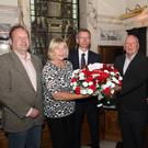 Unionist councillors Graham Craig, Aileen Graham, Brian Kingston, Jeff Dudgeon and Lee Reynolds before laying a wreath at Belfast City Hall